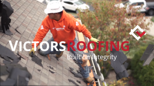 Victors Roofing crew with logo